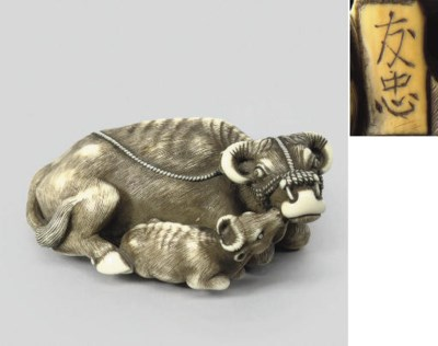 An ivory group of an ox and ca