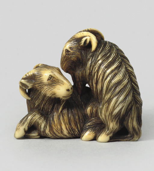 An ivory group of two goats by