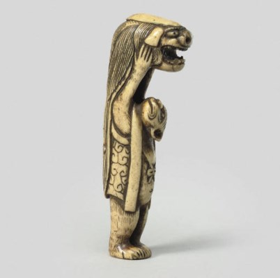 A monkey and shishimai mask, e
