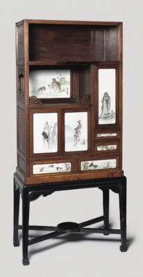 A wood cabinet with cloisonne