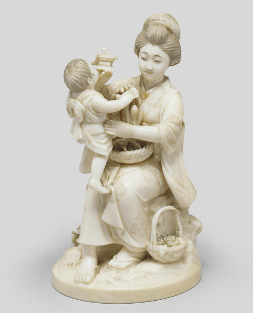 An ivory okimono of mother and