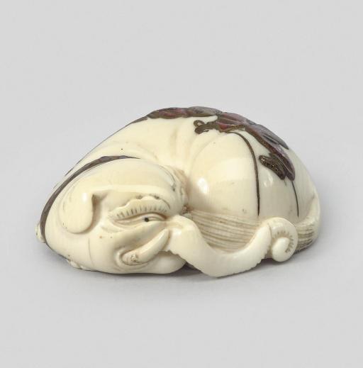 An ivory model of an elephant,