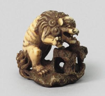 An ivory model of a shishi, ci