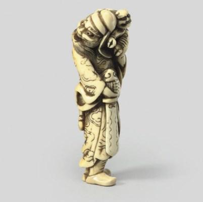 An ivory netsuke of Shoki, sig