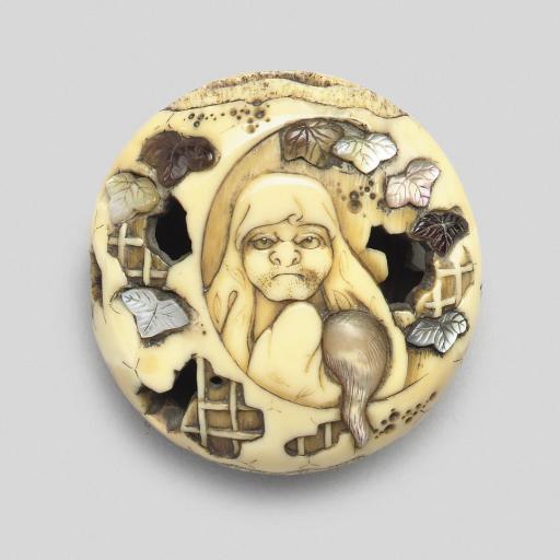 A Shibayama style walrus tooth
