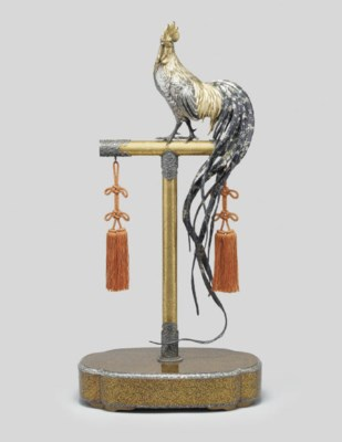 A silvered and gilt model of a