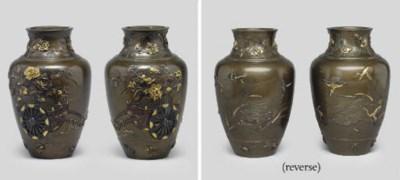 A pair of inlaid bronze vases,