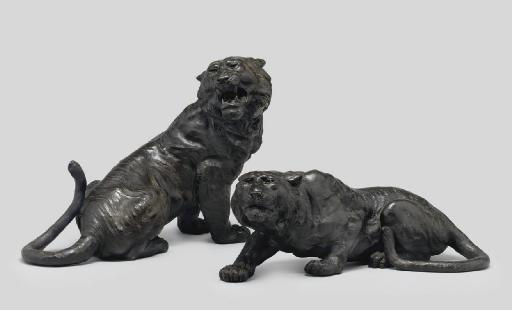 A Pair of bronze models of tig