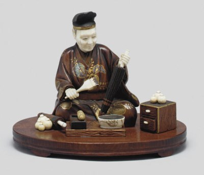 An ivory and wood okimono of a