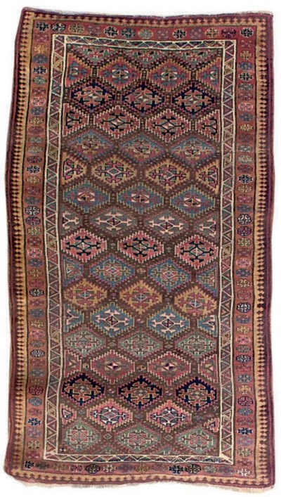 An antique Kurdish rug