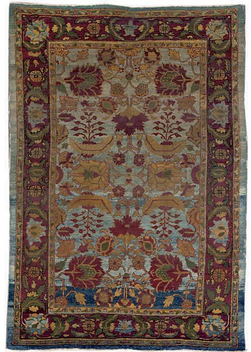 A small antique Agra carpet