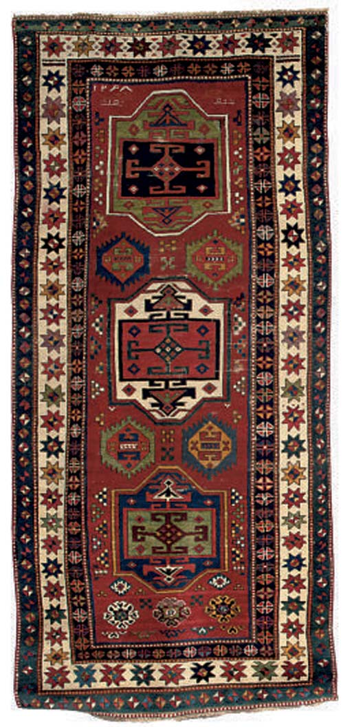 An unusual antique Kazak rug