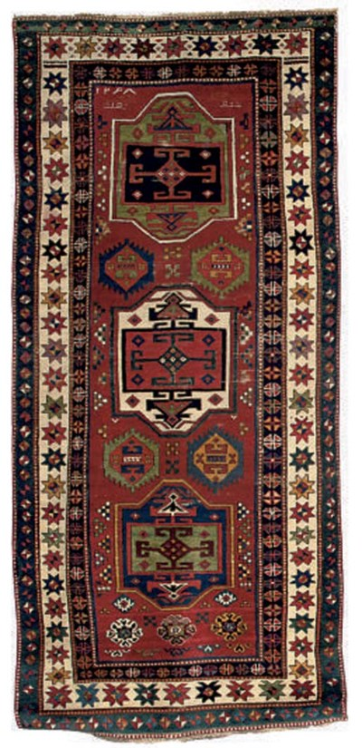 An unusual antique Kazak rug