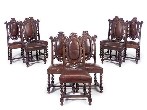 A SET OF NINE OAK DINING CHAIR