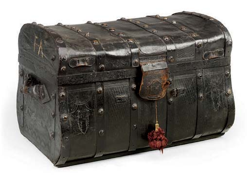 A BRASS-BOUND LEATHER TRUNK