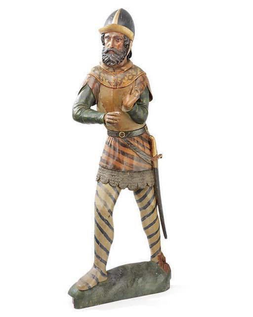 A POLYCHROME DECORATED FIGURE