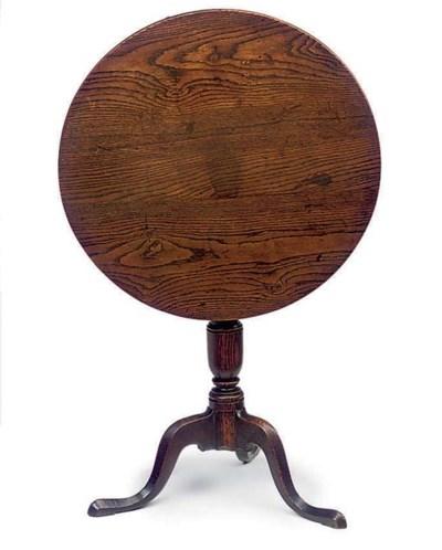 A CIRCULAR OAK OCCASIONAL TABL