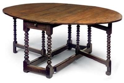 AN OAK DROP LEAF TABLE