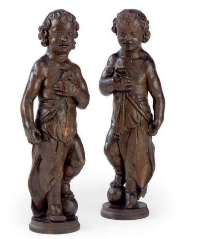 A PAIR OF CARVED FLEMISH ELM P
