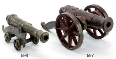 A CAST IRON MODEL OF A CANNON