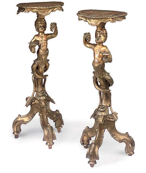 A PAIR OF ITALIAN GILTWOOD FIG