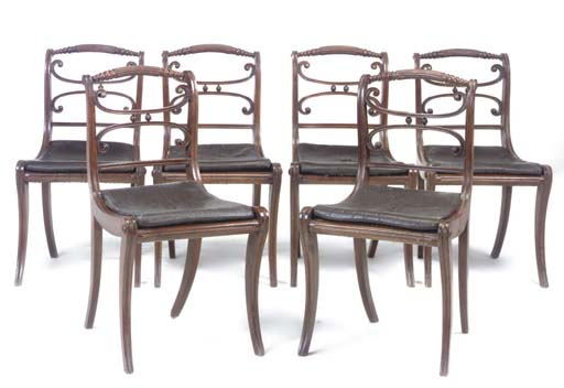 A SET OF SIX REGENCY BEECH AND CANED DINING CHAIRS