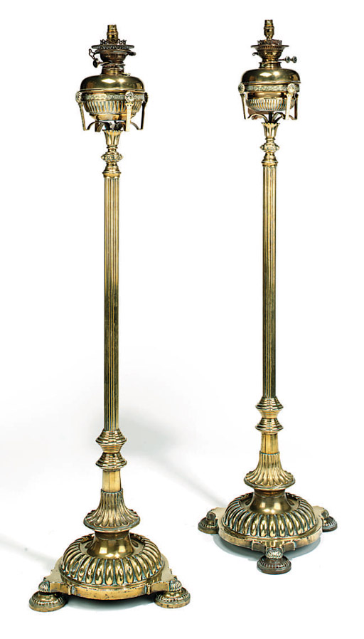 A PAIR OF LATE VICTORIAN BRASS ADJUSTABLE STANDARD LAMPS