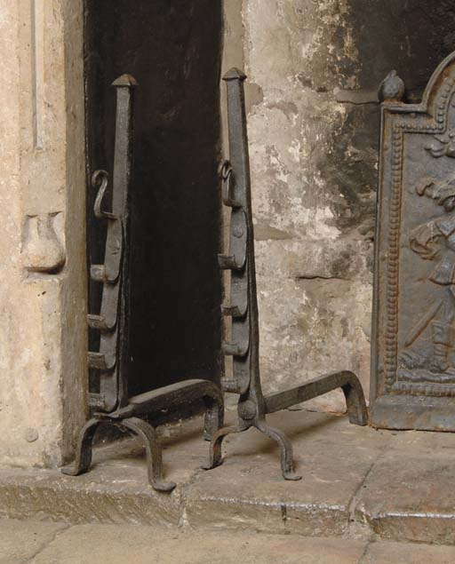 A pair of wrought iron 'spit'