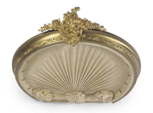 A FRENCH GILT-BRASS BED CORONA