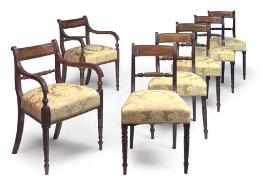 A MATCHED SET OF SEVEN REGENCY MAHOGANY DINING CHAIRS