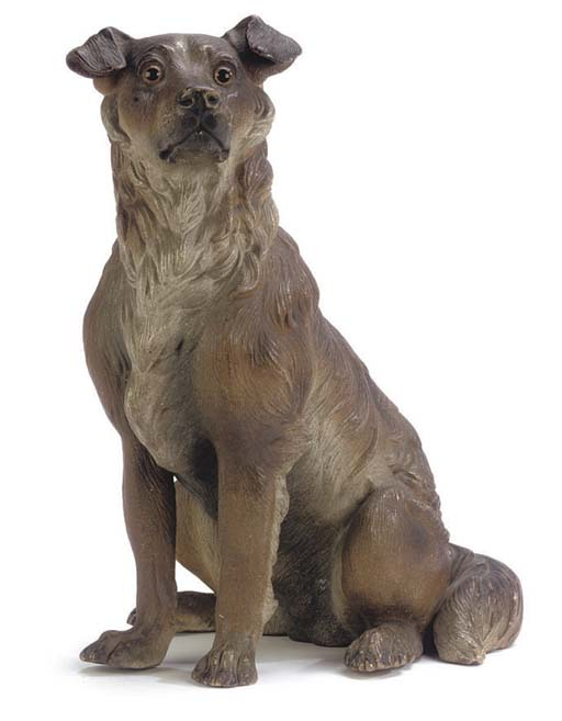 AN AUSTRIAN POLYCHROME DECORATED TERRACOTTA MODEL OF A COLLIE DOG