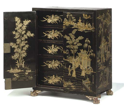 A CHINESE-EXPORT GILT-HEIGHTENED BLACK LACQUER TABLE CABINET