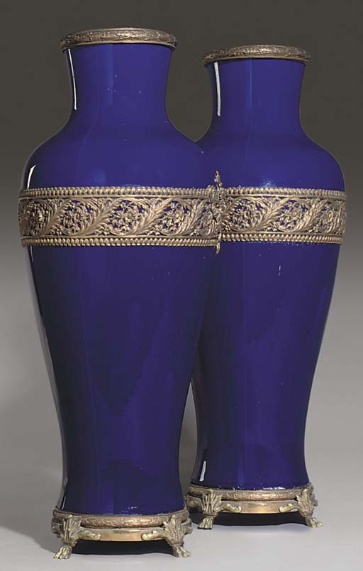 A PAIR OF GILT BRASS MOUNTED PORCELAIN VASES