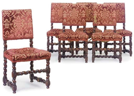 A SET OF SIX OAK DINING CHAIRS