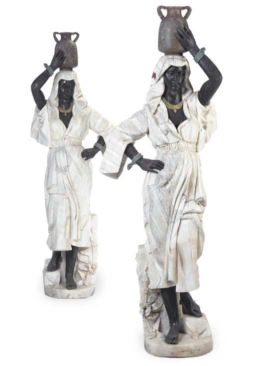 A PAIR OF SCULPTED MARBLE FIGU