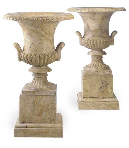 A PAIR OF LARGE MARBLE URNS ON