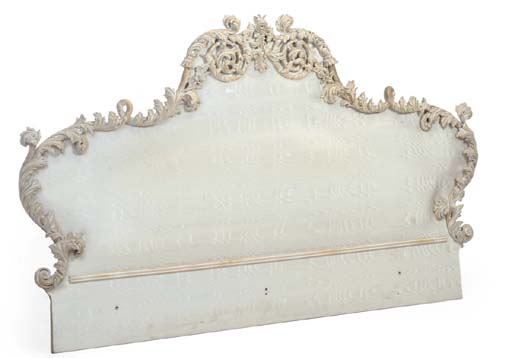 A PAINTED AND UPHOLSTERED BED