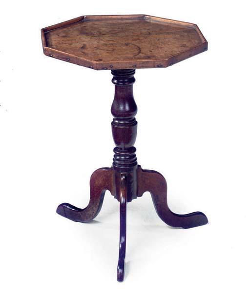 AN OAK OCTAGONAL TRIPOD TABLE