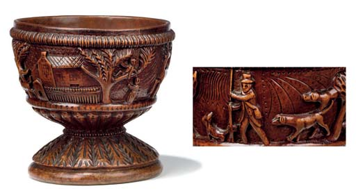 A CARVED MAPLE GOBLET