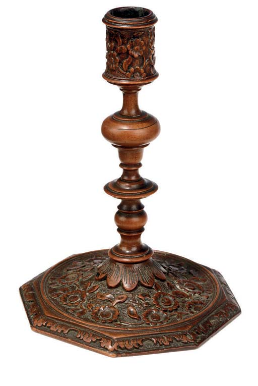 A FRENCH PEARWOOD CANDLESTICK