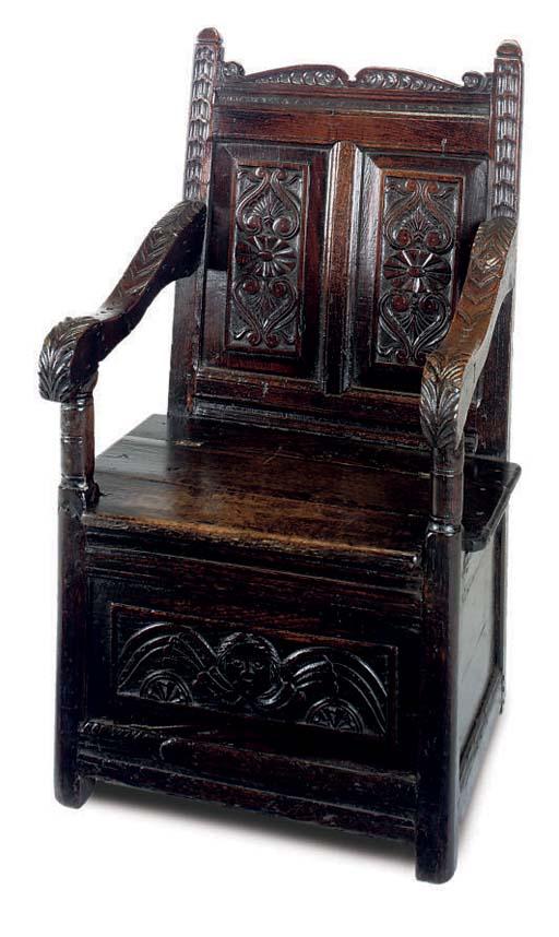 AN ENGLISH OAK BOX-SEAT ARMCHA