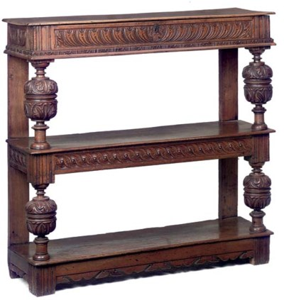 AN ENGLISH OAK THREE-TIER CUP-