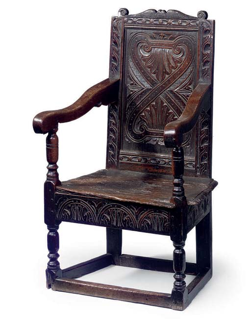 A WEST COUNTRY OAK ARMCHAIR