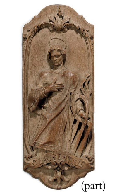 A GERMAN RELIEF CARVED OAK PLA