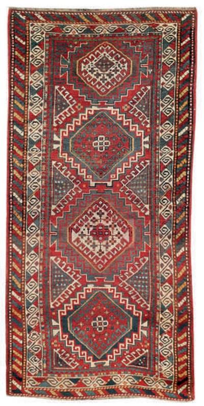 A lot of two antique Kazak rug