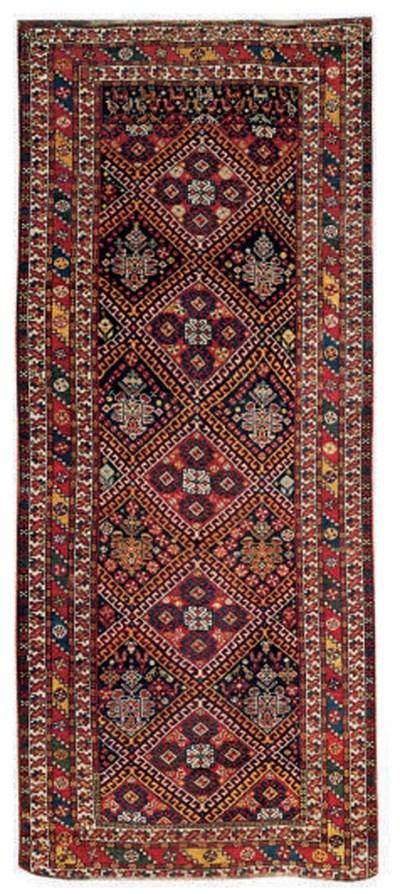 An antique Neriz long rug
