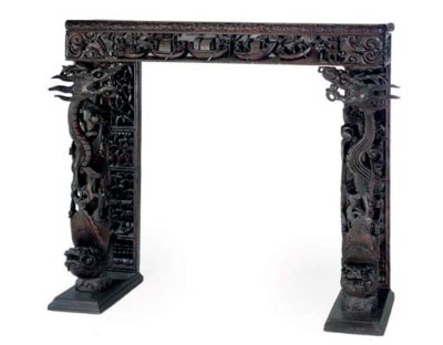 A CHINESE EBONISED AND CARVED