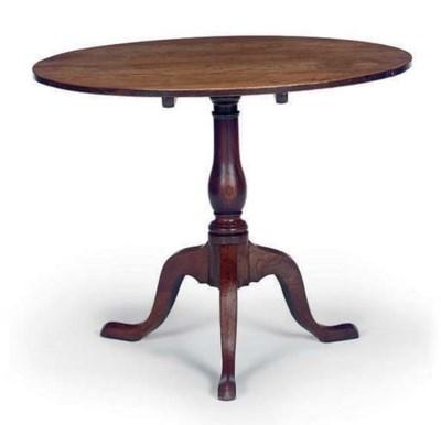 AN OAK TRIPOD TABLE