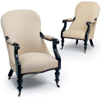 A PAIR OF EBONISED ARMCHAIRS