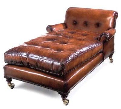 A BROWN LEATHER UPHOLSTERED DA